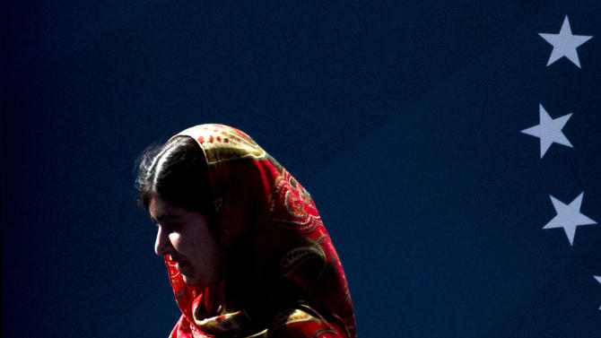 Malala Yousafzai, who is this year's recipient of the Liberty Medal, walks across the stage ahead of a ceremony at the National Constitution Center, Tuesday, Oct. 21, 2014, in Philadelphia. The honor is given annually to an individual who displays courage and conviction while striving to secure liberty for people worldwide. (AP Photo/Matt Rourke)