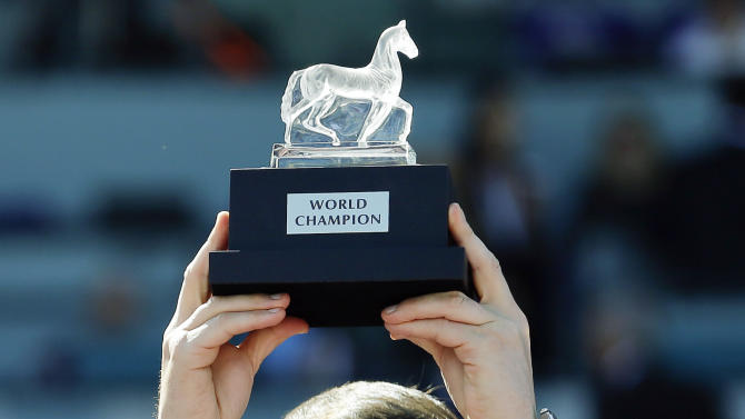 Aidan O'Brien, trainer for George Vancouver, holds up the trophy for the Breeders' Cup Juvenile Turf horse race, Saturday, Nov. 3, 2012, at Santa Anita Park in Arcadia, Calif. (AP Photo/Gregory Bull)