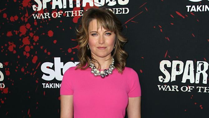 """Lucy Lawless arrives at the premiere of """"Spartacus: War of the Damned"""" on Tuesday, Jan. 22, 2013 in Los Angeles. """"Spartacus: War of the Damned"""" premieres Friday, Jan. 25 at 9PM on STARZ. (Photo by Matt Sayles/Invision for STARZ/AP Images)"""