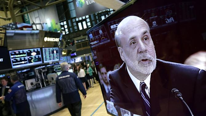 Federal Reserve Chairman Ben Bernanke is seen on a monitor on the floor of the New York Stock Exchange Tuesday, Feb. 26, 2013. The Federal Reserve's low interest-rate policies are giving key support to an economy still burdened by high unemployment,  Bernanke told Congress on Tuesday. Bernanke signaled that the Fed's efforts to keep borrowing costs low will continue. (AP Photo/Richard Drew)