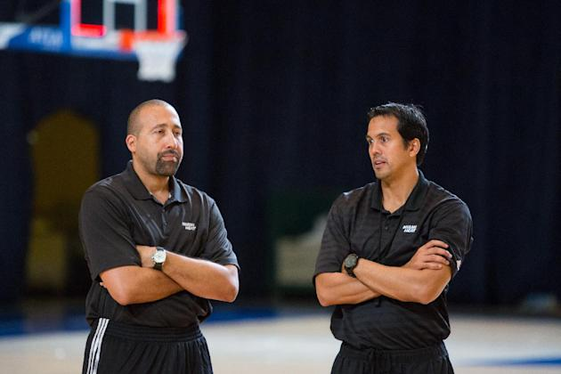 Miami Heat head coach Erik Spoelstra, right, and his assistant David Fizdale talk after training at the Atlantis resort on Paradise Island, Bahamas, Wednesday, Oct. 2, 2013. The two-time defending NBA