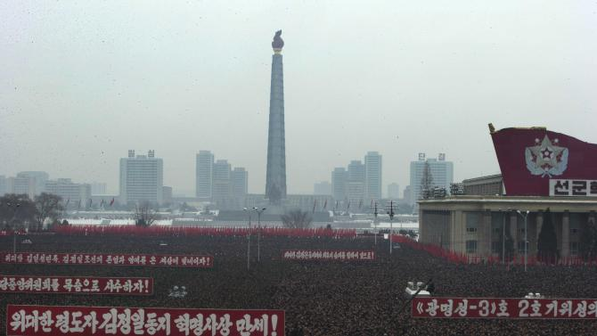Slogans honoring the leadership and celebrating the successful rocket launch of a satellite are displayed during a mass rally on Kim Il Sung Square in Pyongyang, North Korea, Friday, Dec. 14, 2012. As the U.S. led international condemnation of what it calls a covert test of missile technology, top North Korean officials denied the allegations and maintained the country's right to develop its space program. (AP Photo/Ng Han Guan)