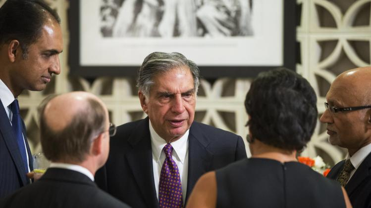 Indian businessman Tata speaks with other dinner attendees before a dinner at the U.S. Ambassador's residence in New Delhi