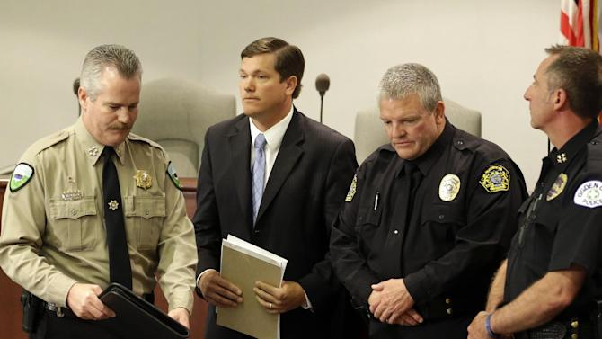 Weber County Sheriff Terry Thompson, from left, Weber County Attorney Dee Smith, Greg Whinham, Roy City, Chief of Police and Mike Ashment, Ogden Chief of Police, appear after a news conference Friday, May 24, 2013, in Ogden, Utah. Matthew David Stewart, a Utah Army veteran charged with killing a police officer and wounding five others in a shootout during a marijuana raid was found Friday hanging dead in his cell, authorities said. Stewart, 39, was found hanging from a bed sheet during a routine cell check just before 1 a.m., Weber County Attorney Dee Smith said. The county has referred the investigation into the death to an outside agency, and another county attorney will review it. (AP Photo/Rick Bowmer)