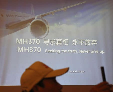 Relatives of some of the Chinese passengers who were on board MH370 outline their demands to the airline in Kuala Lumpur