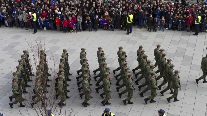 Kosovo Security Force members parade in the center of Pristina marking the 5th anniversary since Kosovo seceded from Serbia on Sunday, Feb. 17, 2013. Serbia rejects Kosovo's independence. (AP Photo/Visar Kryeziu)