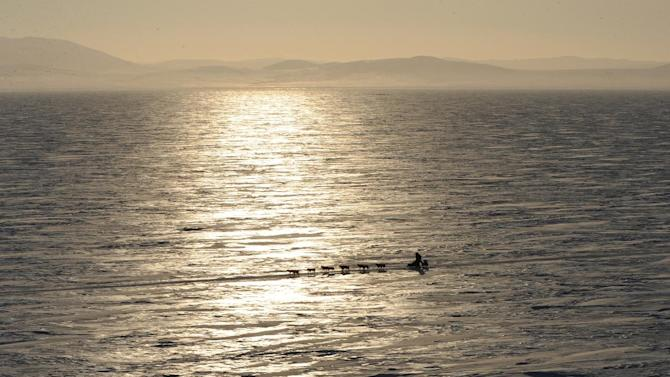 A musher travels across Norton Sound on their way to Koyuk in Alaska during the Iditarod Trail Sled Dog Race on Monday, March 11, 2013. (AP Photo/The Anchorage Daily News, Bill Roth)