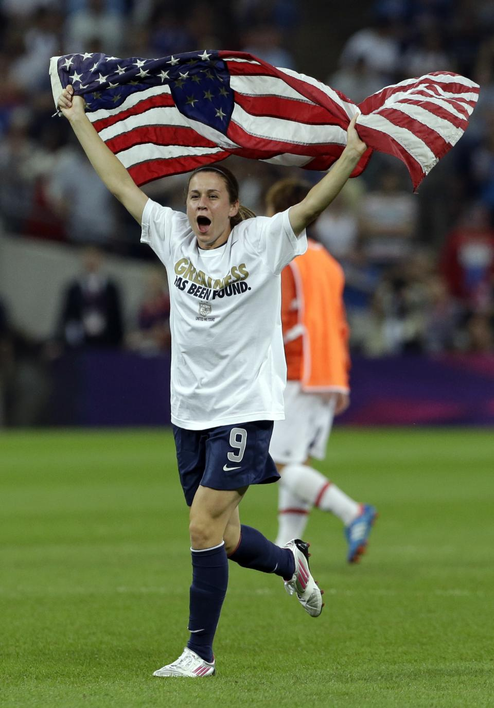 United States' Heather O'Reilly celebrates after winning the women's soccer gold medal match against Japan at the 2012 Summer Olympics, Thursday, Aug. 9, 2012, in London. (AP Photo/Ben Curtis)