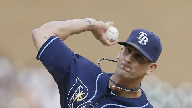 FILE - In this July 5, 2014, file photo, Tampa Bay Rays relief pitcher Grant Balfour throws during the ninth inning of a baseball game against the Detroit Tigers in Detroit. Balfour's return to the Rays didn't go as well as expected, and the reliever is motivated to rebound with a productive season. (AP Photo/Carlos Osorio, File)