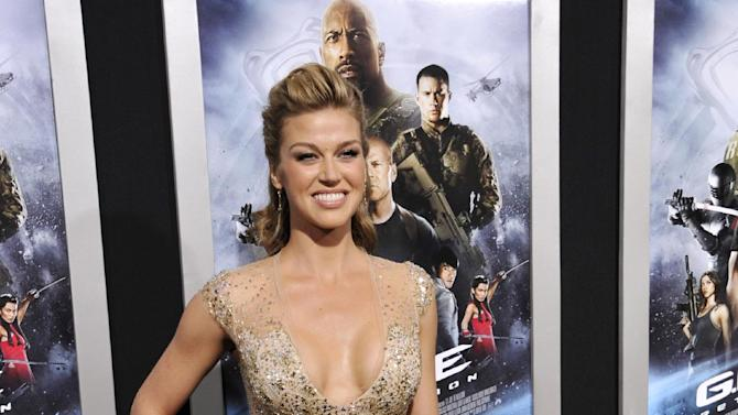 """Adrianne Palicki, a cast member in """"G.I. Joe: Retaliation,"""" poses at the Los Angeles premiere of the film at the TCL Chinese Theatre on Thursday, March 28, 2013 in Los Angeles. (Photo by Chris Pizzello/Invision/AP)"""