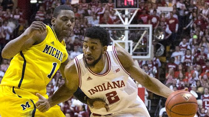 Indiana's Christian Watford (2) drives the ball up court against Michigan's Glenn Robinson III (1) during the second half of an NCAA college basketball game Saturday, Feb. 2, 2013, in Bloomington, Ind. Indiana defeated Michigan 81-73. (AP Photo/Doug McSchooler)