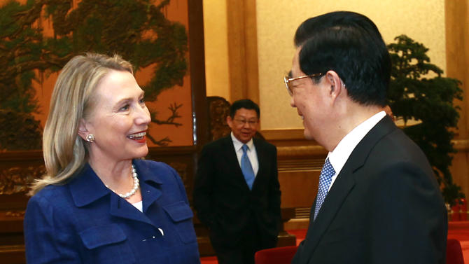 U.S. Secretary of State Hillary Rodham Clinton, left, is greeted by China's President Hu Jintao during their meeting at the Great Hall of the People in Beijing Friday, May 4, 2012. (AP Photo/Shannon Stapleton, Pool)