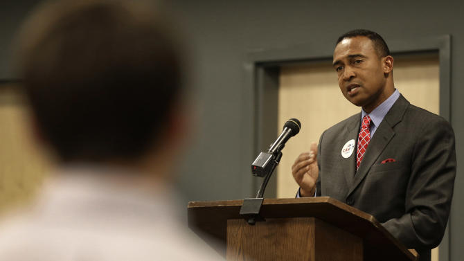 In this Oct. 29, 2013 photo Patrick Cannon, Democratic candidate for mayor speaks to students at Queens University in Charlotte, N.C. Cannon faces Republican Edwin Peacock in the Nov. 5, 2013, election. In North Carolina's largest city, the mayoral race has been a lesson in good behavior. Unlike statewide and national races, there's been no mudslinging. No blistering attack ads. Just two candidates going from public forum to forum, discussing the issues. (AP Photo/Chuck Burton)