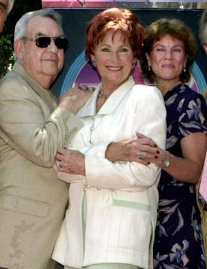 """FILE - In this July 12, 2001 file photo, from left, actors Tom Bosley, Marion Ross, and Erin Moran, Williams, of the television show """"Happy Days,"""" pose  after Ross received a star on the Hollywood Walk of Fame in the Hollywood section of Los Angeles. A Los Angeles judge on Tuesday, June 5, 2012 denied a motion by CBS Studios and Paramount Pictures to dismiss claims by several former """"Happy Days"""" cast members that they are owed royalties on DVD sales of the hit comedy series. A trial is scheduled for July.  The lawsuit was brought by cast members including Ross, Moran and Patricia Bosley, wife of Tom Bosley, who died of heart failure on Oct. 19, 2010. (AP Photo/E.J. Flynn, file)"""