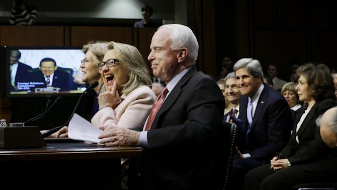 Senate Foreign Relations Chairman Sen. John Kerry, D-Mass., second from right, and his wife Teresa Heinz, right, watch as Secretary of State Hillary Rodham Clinton, center, flanked by Sen. Elizabeth Warren, D-Mass., left , and Sen. John McCain, R-Ariz, reacts during the start of his Kerry's confirmation hearing to replace Clinton, Thursday, Jan. 24, 2013, on Capitol Hill in Washington.  (AP Photo/Pablo Martinez Monsivais)