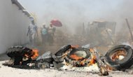Tires burn on September 20, in the Sondela informal settlement next to the Anglo American Platinum mine in northwestern Rustenburg after residents blocked roads to keep the police out. Anglo American ordered 26,000 striking workers in South Africa to report for disciplinary hearings on Tuesday or risk the sack, as gold giant AngloGold Ashanti warned strikers there they might scale down operations