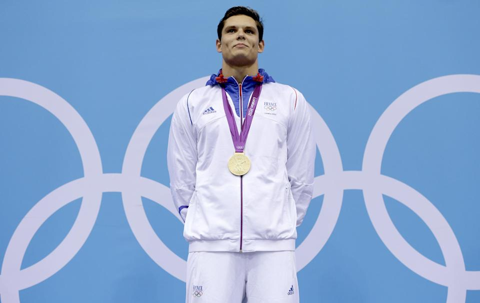 France's Florent Manaudou holds his gold medal in the men's 50-meter freestyle swimming final at the Aquatics Centre in the Olympic Park during the 2012 Summer Olympics in London, Friday, Aug. 3, 2012. (AP Photo/Michael Sohn)