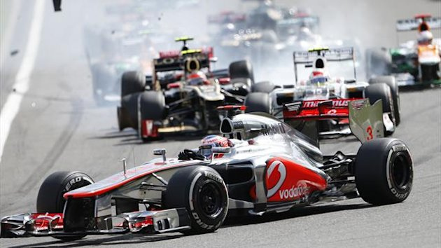 McLaren Formula One driver Jenson Button (Front C) of Britain leads the pack while Lotus Formula One driver Romain Grosjean (Back) of France crashes at the start of the Belgian Grand Prix in Spa Francorchamps (Reuters)
