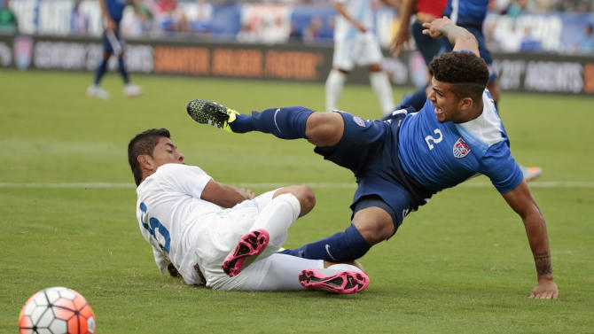 United States' DeAndre Yedlin (2) collides with Guatemala midfielder Carlos Mejia (6) in the first half of an international friendly soccer match Friday, July 3, 2015, in Nashville, Tenn. (AP Photo/Mark Humphrey)