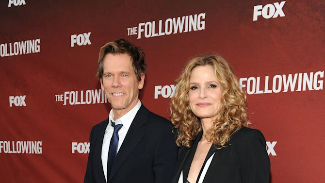 "Actors Kevin Bacon (left) and Kyra Sedgwick arrive at FOX's ""The Following"" finale screening at the Academy of Television Arts & Sciences' Leonard H. Goldenson Theater on Monday, April 29, 2013 in North Hollywood, California. (Photo by Frank Micelotta/Invision for FOX/AP Images)"
