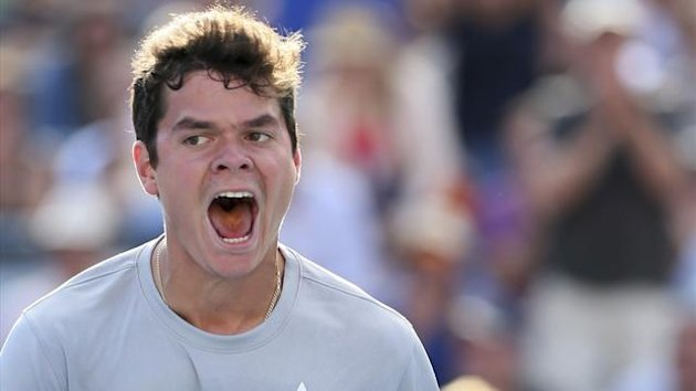 Canada's Milos Raonic celebrates his win over compatriot Vasek Pospisil during the men's Rogers Cup semi-finals tennis tournament match in Montreal August 10, 2013 (Reuters)