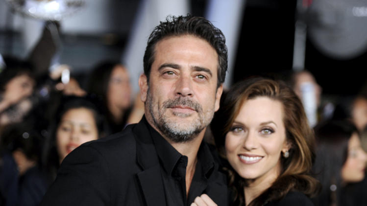 "Jeffrey Dean Morgan, left, and Hilarie Burton arrive at the world premiere of ""The Twilight Saga: Breaking Dawn - Part 1"" on Monday, Nov. 14, 2011, in Los Angeles. (AP Photo/Chris Pizzello)"