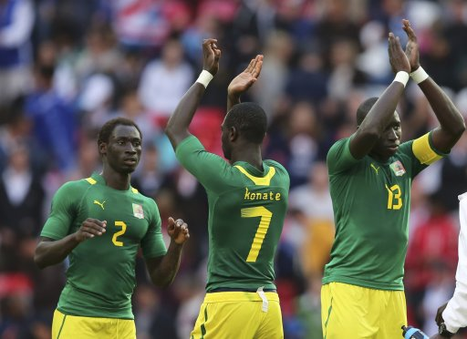 Senegal's Saliou Ciss, Moussa Konate and Mohamed Diame celebrate victory against Uruguay after their men's preliminary first round Group A soccer match at the London 2012 Olympic Games in the Wembley Stadium in London
