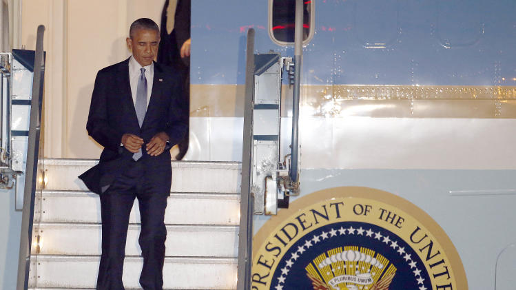President Barack Obama walks down the stairs of Air Force One upon his arrival at San Francisco International Airport, Tuesday, July 22, 2014, in San Francisco. (AP Photo/Tony Avelar)