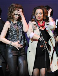 "Actors Sandra Bernhard, left, and Maya Rudolph perform together during the encore at ""The Music of Prince"" tribute concert at Carnegie Hall on Thursday March 7, 2013 in New York. (Photo by Evan Agostini/Invision/AP)"