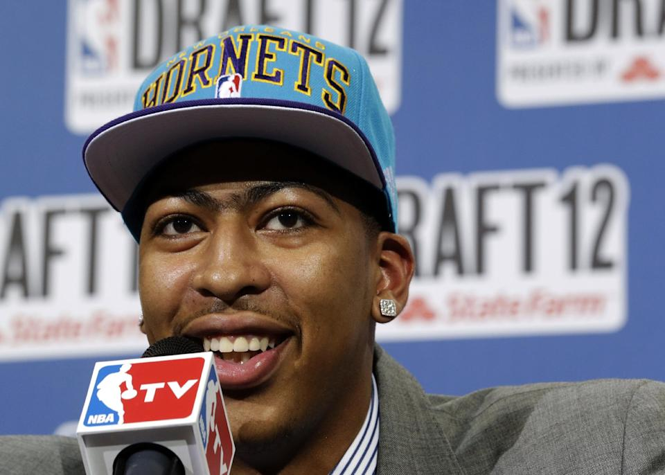 Kentucky's Anthony Davis smiles while talking about his unibrow as he answers questions from reporters after being drafted No. 1 overall by the New Orleans Hornets during the NBA basketball draft, Thursday, June 28, 2012, in Newark, N.J. (AP Photo/Julio Cortez)