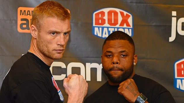 Former England cricketer turned professional boxer Andrew Flintoff (L) and US boxer Richard Dawson pose for pictures following a press conference at the MEN Arena in Manchester, north-west England, on November 2