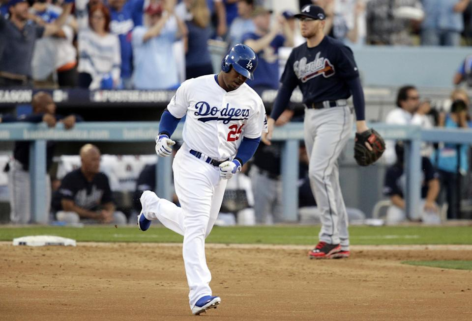 Los Angeles Dodgers' Carl Crawford rounds the bases after he hit a three-run home run during the second inning in Game 3 of the National League division baseball series against the Atlanta Braves, Sunday, Oct. 6, 2013, in Los Angeles. (AP Photo/Jae C. Hong)