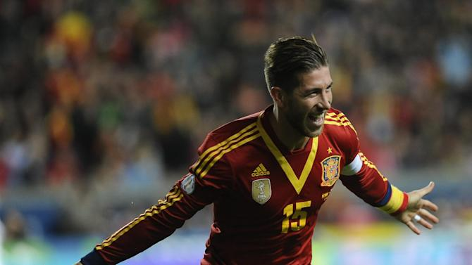 Spain's defender Sergio Ramos celebrates a goal during the FIFA 2014 World Cup qualifier match against Finland at the Molinon stadium in Gijon on March 22, 2013