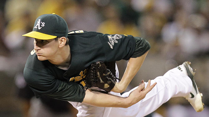 Oakland Athletics' Jarrod Parker works against the Texas Rangers in the first inning of a baseball game Monday, Oct. 1, 2012, in Oakland, Calif. (AP Photo/Ben Margot)