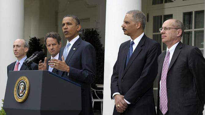 President Barack Obama announces a plan to increase oversight and crack down on manipulation in oil markets during a statement in the Rose Garden of the White House in Washington, Tuesday, April 17, 2012. From left are , Chairman of the Commodity Futures Trading Commission (CFTC) Chairman Gary Gensler, Treasury Secretary Timothy Geithner, the president, Attorney General Eric Holder, and FTC Chairman Jon Leibowitz. (AP Photo/Susan Walsh)