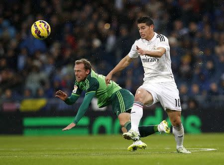 Real Madrid's Rodriguez fights for the ball with Celta Vigo's Krohn-Dehli during their Spanish First Division soccer match in Madrid
