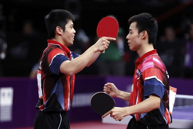 Chen and Chuang of Taiwan react after defeating Hao and Ma of China in their men's doubles final match at the World Team Table Tennis Championships in Paris