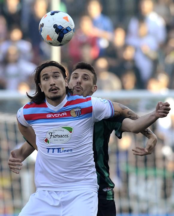 Sassuolo's Alessandro Longhi, right, competes for the ball with Catania's Sebastian Leto of Argentina, during their Serie A soccer match at Reggio Emilia's Mapei stadium, Italy, Sunday, Ma