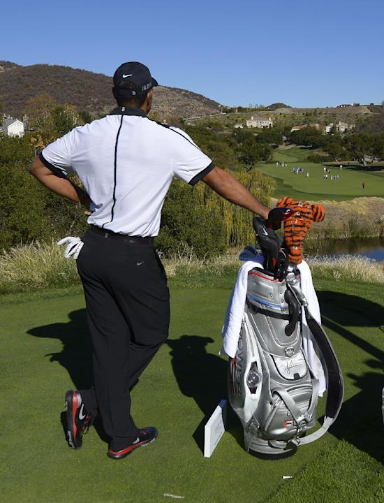 Tiger Woods waits to hit on the 13th hole during the pro-am portion of the Northwestern Mutual World Challenge golf tournament at Sherwood Country Club, Wednesday, Dec. 4, 2013, in Thousand Oaks, Cali