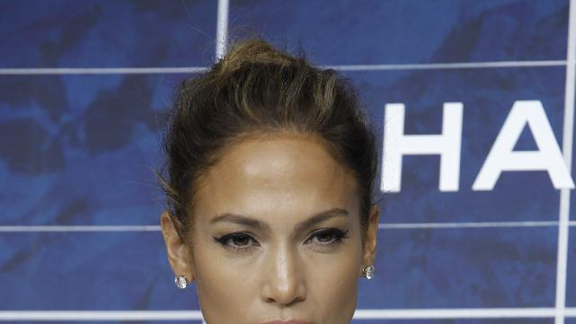 "FILE - In this Oct. 2, 2012 file photo, Jennifer Lopez arrives for the presentation of Chanel's ready-to-wear Spring-Summer 2013 collection in Paris. Lopez has launched her ""J. Lo's Christmas Gift"" drive, asking fans to donate to her three favorite charities (the Boys & Girls Club, the Children's Hospital of Los Angeles and the American Red Cross). In exchange, she'll give someone two tickets to the last show of her ""Dance Again"" world tour in Puerto Rico on Saturday, Dec. 22, 2012. (AP Photo/Thibault Camus, File)"