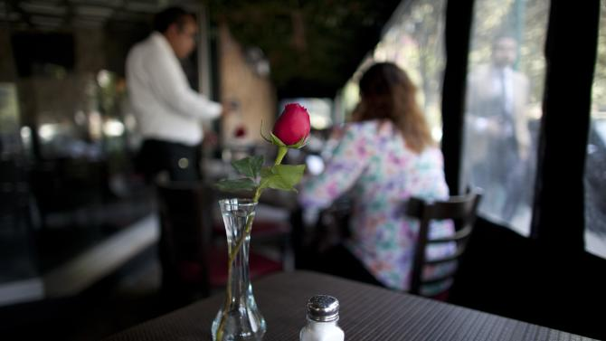 """In this April 9, 2013 photo, a salt shaker sits on a table in a restaurant in Mexico City. The country's Health Secretary Armando Ahued launched a campaign, dubbed """"Less Salt, More Health,"""" to get restaurants to take salt shakers off their tables. Officials and the city's restaurant chamber signed an agreement to encourage eateries to provide shakers only if guests ask for them. The program is voluntary but the chamber is urging its members to comply. (AP Photo/Alexandre Meneghini)"""