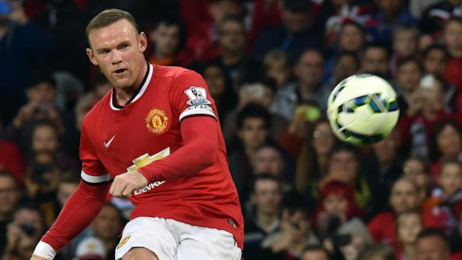 Manchester United striker Wayne Rooney takes a free kick during the pre-season friendly match between Manchester United and Valencia at Old Trafford in Manchester on August 12, 2014