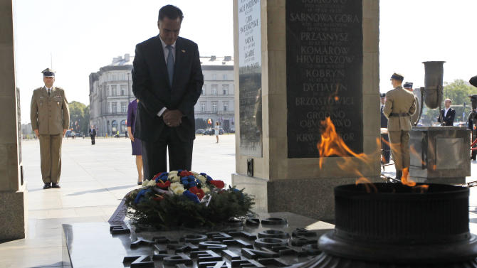 Republican presidential candidate and former Massachusetts Gov. Mitt Romney visits the Tomb of the Unknown Soldier in Warsaw, Poland, Tuesday, July 31, 2012. (AP Photo/Charles Dharapak)
