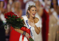 FILE - In this Jan. 12, 2013 file photo, Miss New York Mallory Hytes Hagan reacts as she is crowned Miss America 2013 in Las Vegas. Gov. Chris Christie&#39;s spokesman Michael Drewniak on Wednesday night, Feb. 13, 2013 confirmed news of the Miss America pageant&#39;s return to Atlantic City. Lt. Gov. Kim Guadagno is scheduled make a formal announcement Thursday on Atlantic City&#39;s Boardwalk Hall. (AP Photo/Isaac Brekken, File)