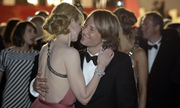 Actress Nicole Kidman, left, and musician Keith Urban embrace as they depart following the screening of The Paperboy at the 65th international film festival, in Cannes, southern France, Thursday, May