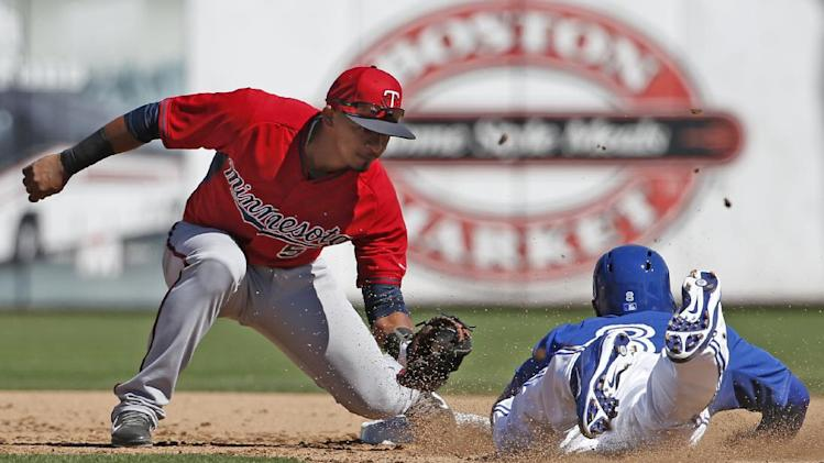 Minnesota Twins shortstop Eduardo Escobar (5) catches Toronto Blue Jays' Anthony Gose stealing in the fifth inning of an exhibition baseball game in Dunedin, Fla., Saturday, March 8, 2014. The Jays defeated the Twins 4-3
