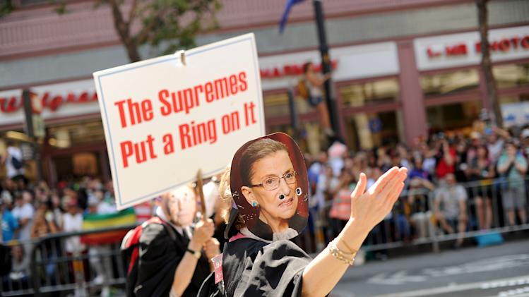 Wearing a mask of U.S. Supreme Court Justice Ruth Bader Ginsburg, a reveler marches in San Francisco's 43rd annual gay pride parade Sunday, June 30, 2013. Participants bore signs and clothing celebrating the court's Wednesday ruling that cleared the way for same-sex marriages to resume in California. (AP Photo/Noah Berger)