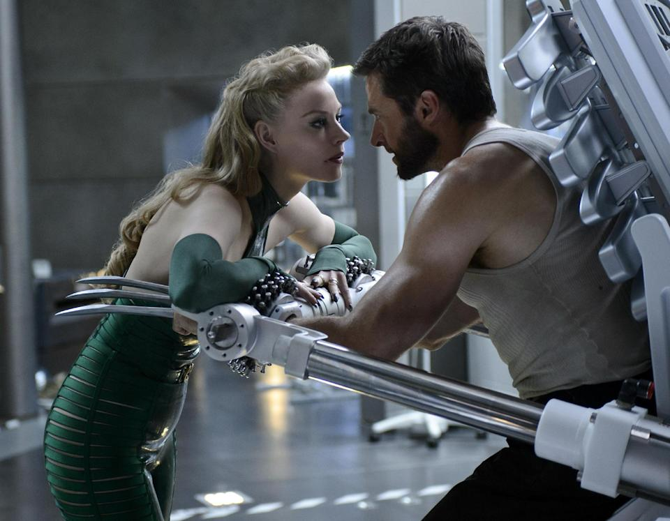 "This publicity image released by 20th Century Fox shows Svetlana Khodchenkova as Viper, left, and Hugh Jackman as Logan in a scene from ""The Wolverine."" (AP Photo/20th Century Fox, Ben Rothstein)"
