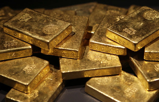 """<p> FILE - In this Nov. 8, 2006 file photo, gold bars are on display at the """"Gold"""" exhibit in the American Museum of Natural History in New York. Gold, often touted as the most trustworthy of investments, has looked wild over the past month. After starting April 2013 above $1,600 an ounce, it dropped below $1,361 on April 15 and has steadily recovered to settle at $1,436 on Friday, May 10, 2013. (AP Photo/Seth Wenig, File)"""