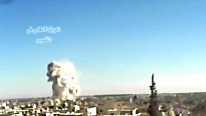 This image made from video posted by Ugarit News and taken on Wednesday, May 29, 2013, which is consistent with other AP reporting, shows an explosion from shelling in Qusair, Syria. Syrian President Bashar Assad said the regime has received its first shipment of a sophisticated Russian anti-aircraft missile system, and the main Western-backed opposition group announced Thursday that it will not participate in peace talks — a double blow to international efforts to end the country's devastating civil war. (AP Photo/Ugarit News via AP video)